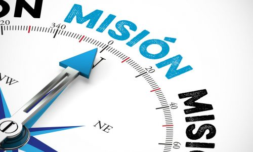 Pfeil von einem Kompass zeigt in Richtung Misión / Mission